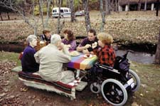 woman in wheelchair with family at picnic